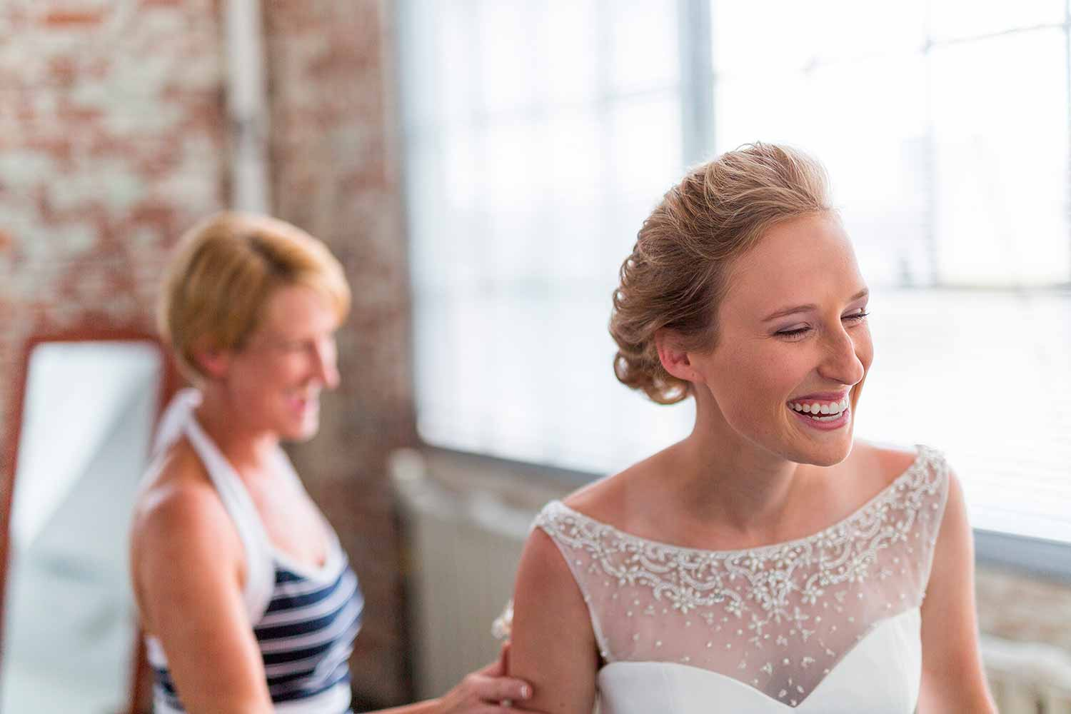 Mother and daughter laughing at wedding